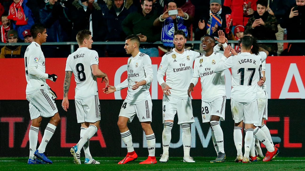 Real Madrid players celebrate after scoring a goal against Girona in the Copa del Rey.