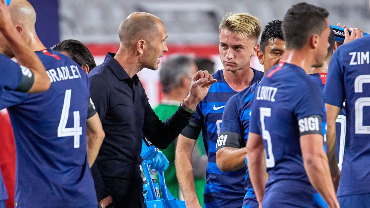 United States head coach Gregg Berhalter talks to midfielder Djordje Mihailovic during a friendly with Panama.