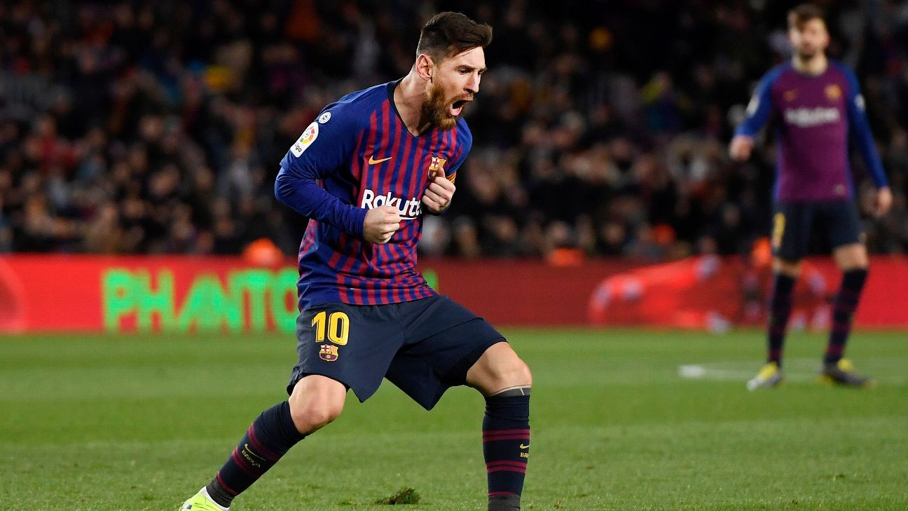 Lionel Messi celebrates after scoring in Barcelona's La Liga draw against Valencia.