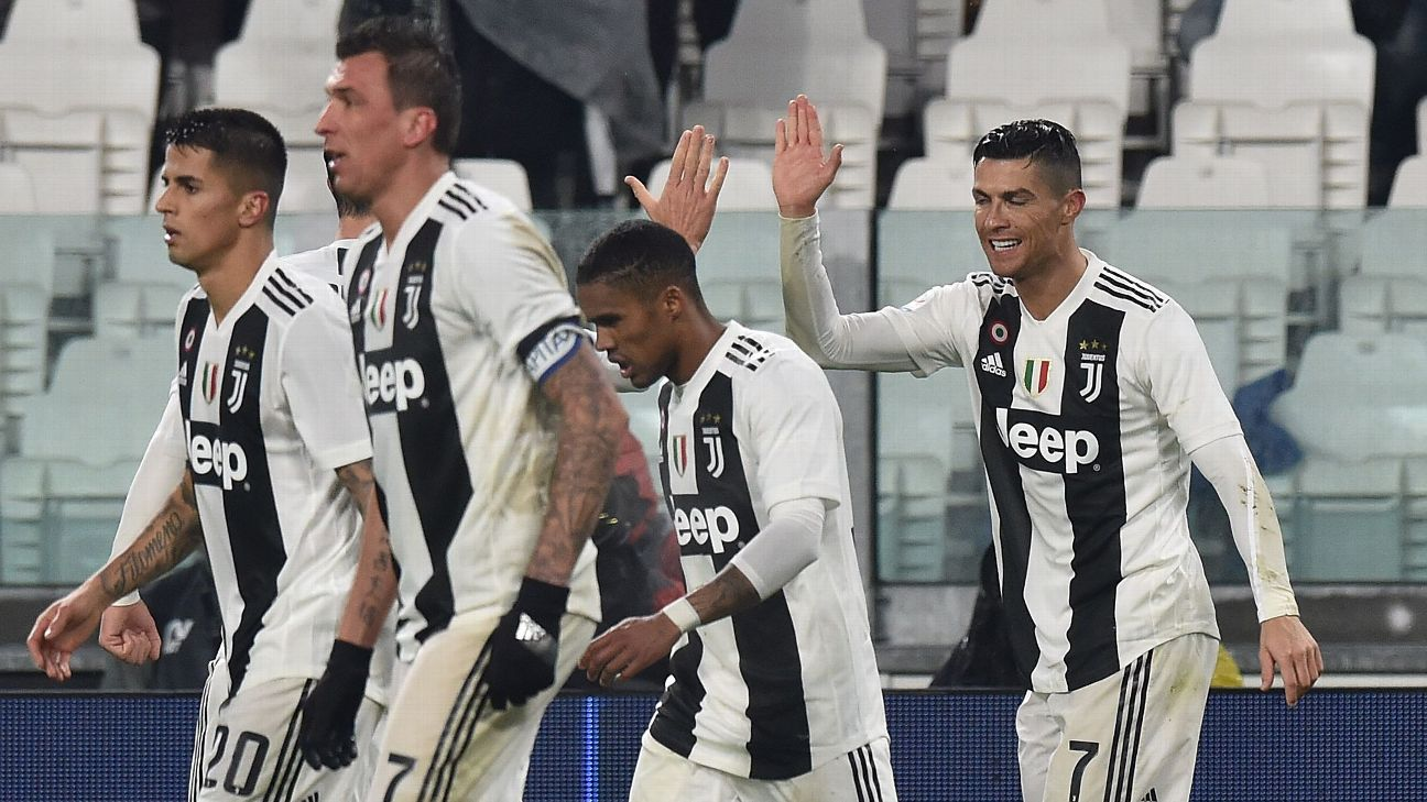 Cristiano Ronaldo, right, celebrates with teammates after scoring a goal against Parma in Serie A.