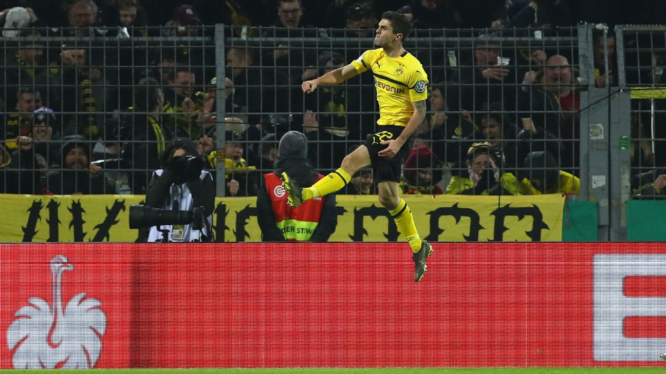 Dortmund's Christian Pulisic celebrates after scoring a goal in the German DFB Pokal against Werder Bremen.