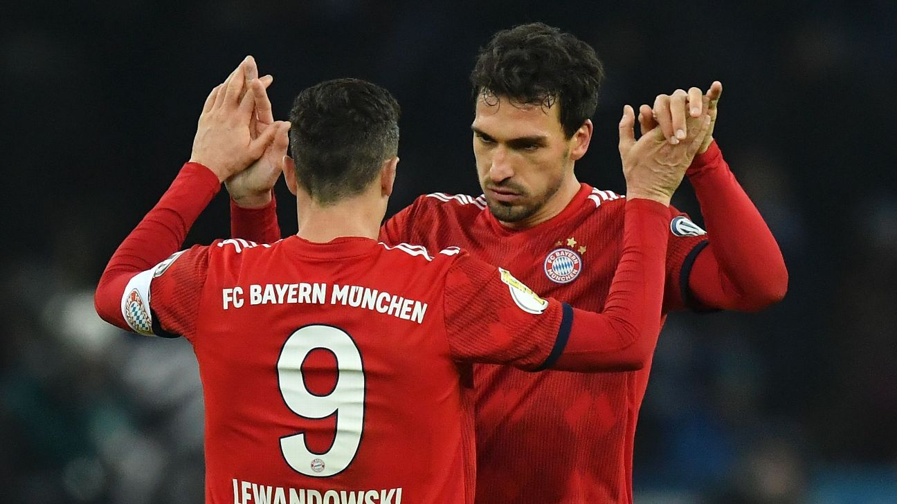 Mats Hummels, right, congratulates Robert Lewandowski during Bayern Munich's DFB Pokal win against Hertha.