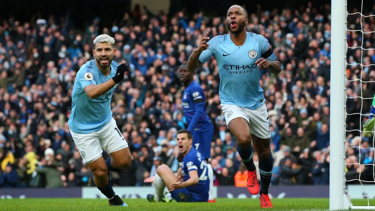 Raheem Sterling, right, celebrates after scoring the opener for Manchester City against Chelsea.