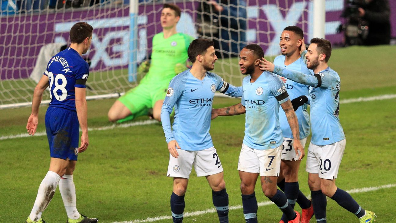 Man City players celebrate after scoring a goal against Chelsea.