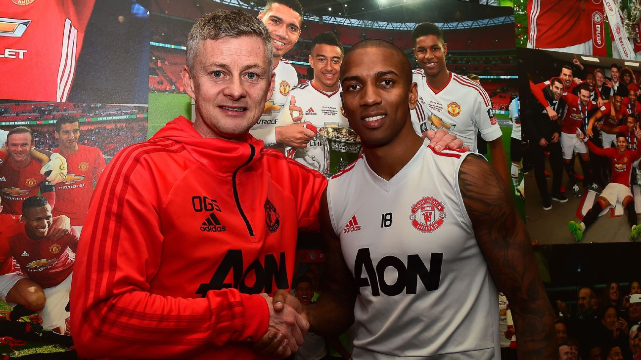 Ashley Young with Manchester United caretaker Manager Ole Gunnar Solskjaer