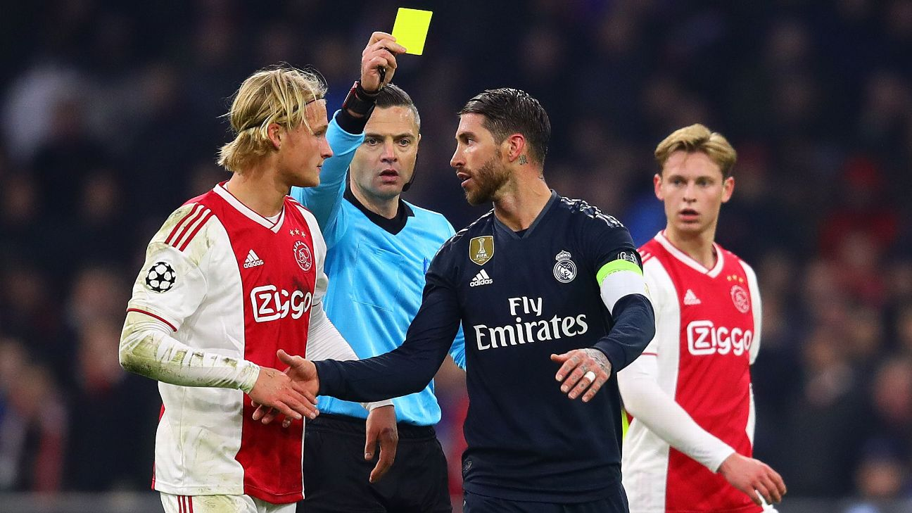 Sergio Ramos is shown a yellow card following a late foul on Ajax forward Kasper Dolberg