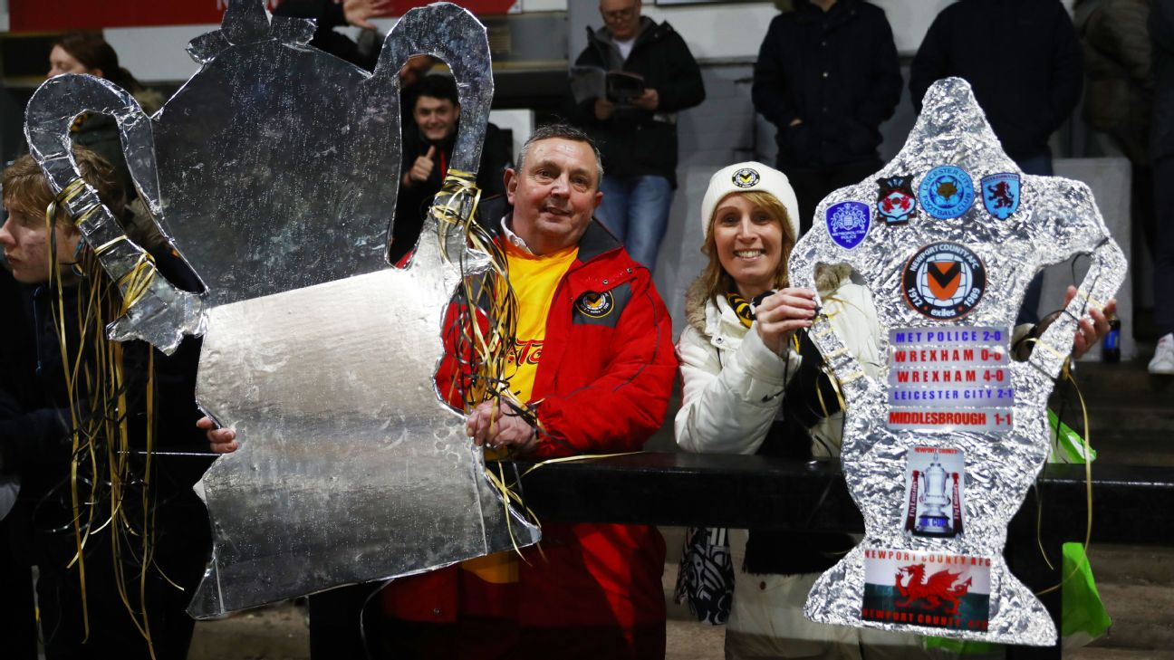 Fans show their tin foil FA Cups during the FA Cup Fourth Round Replay match between Newport County AFC and Middlesbrough