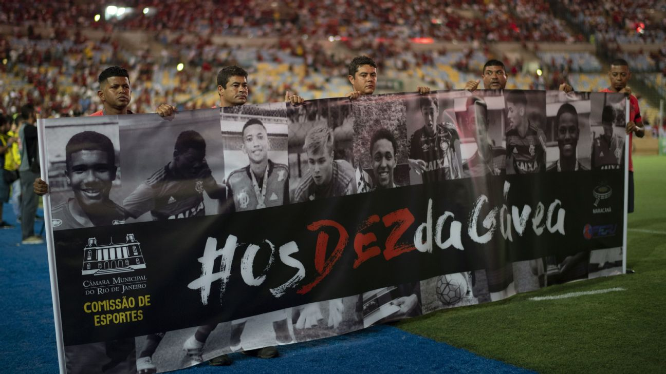 Flamengo supporters hold up a poster in honour of the 10 youth academy players that died in a dormitory fire.