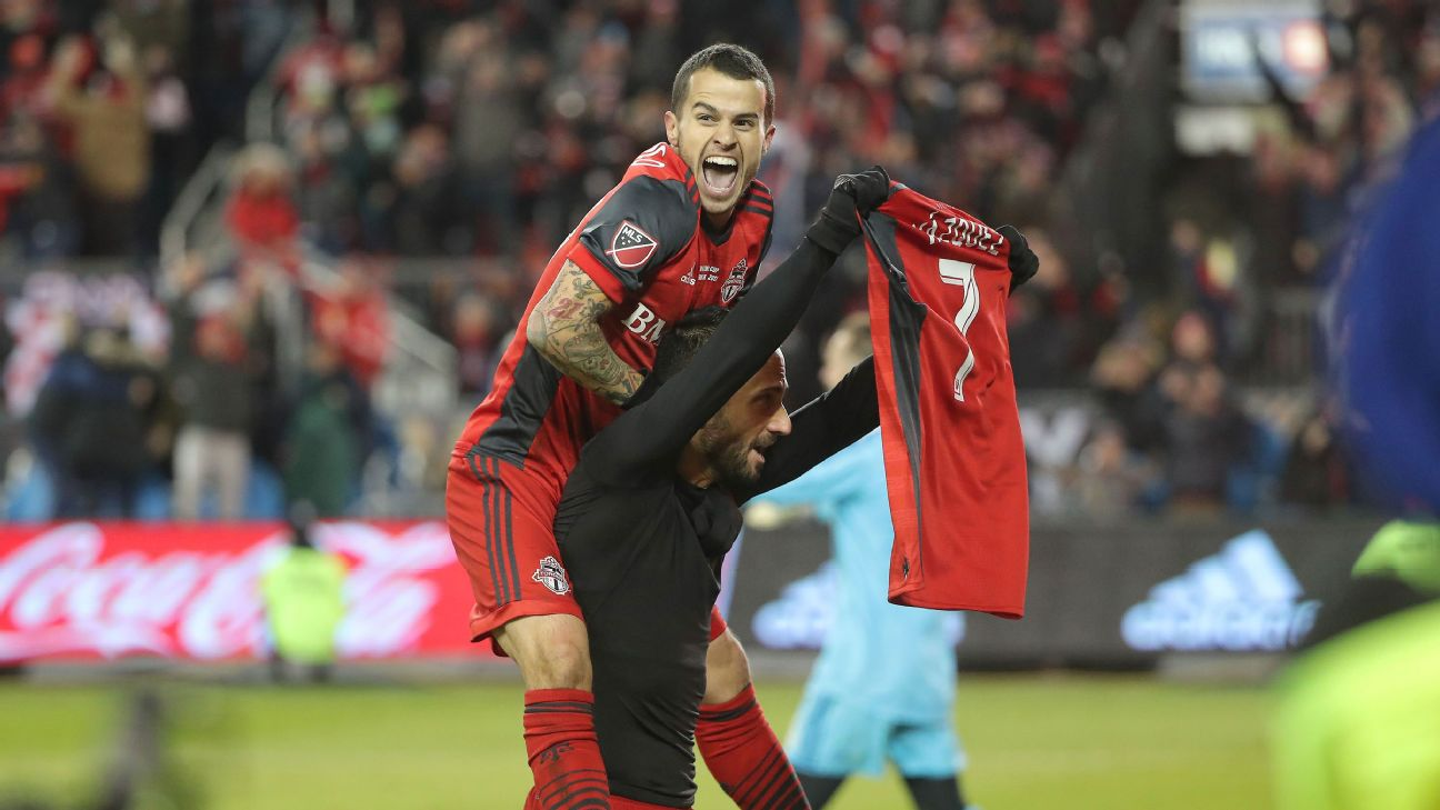 Sebastian Giovinco and Victor Vazquez celebrate during Toronto FC's MLS Cup win over the Seattle Sounders.