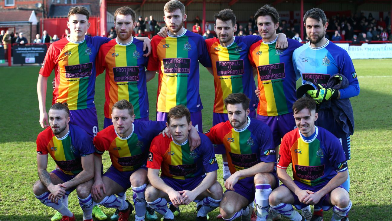 Altrincham players wear their multicoloured Football Vs. Homophobia kit before their match against Bradford Park Avenue.