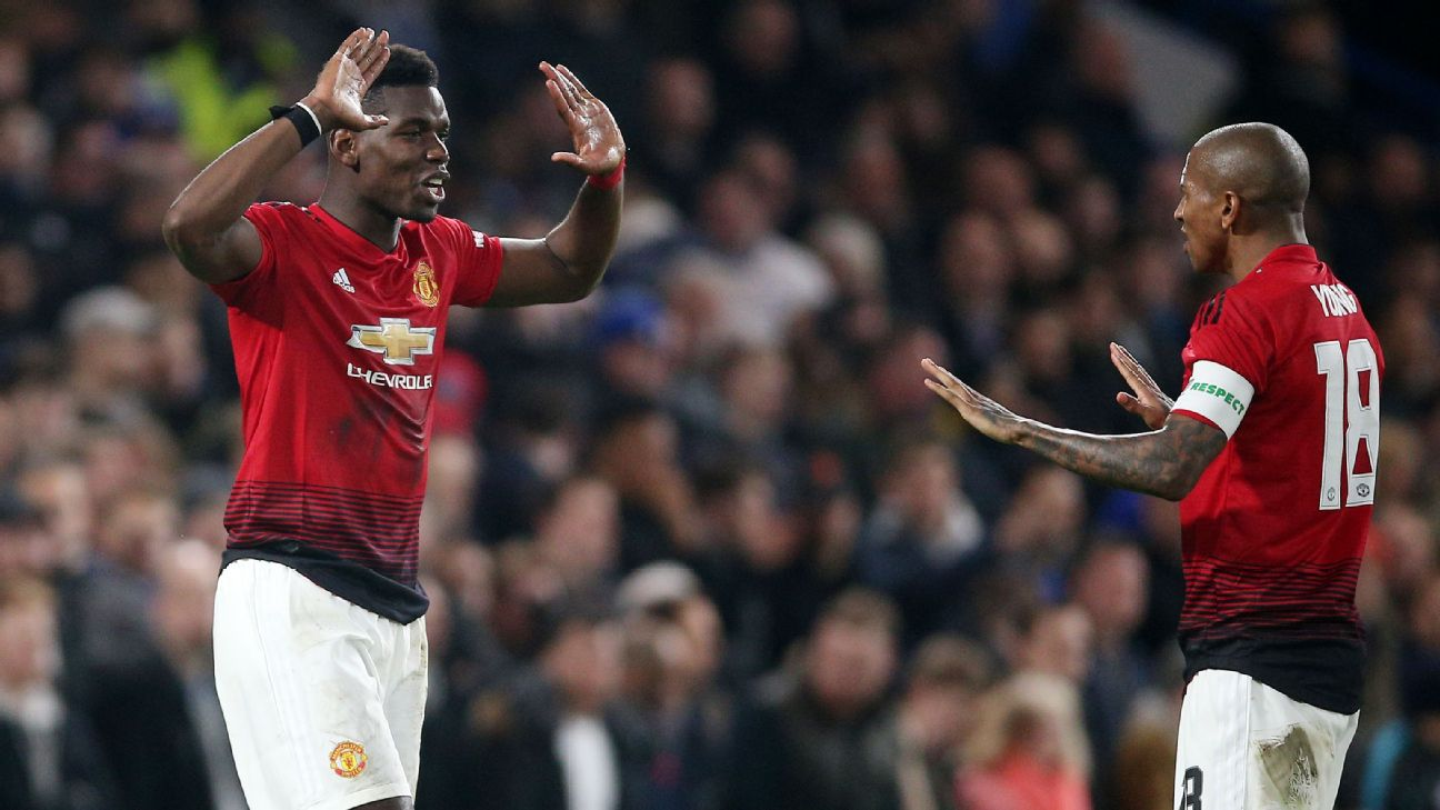 Paul Pogba and Ashley Young celebrate during Manchester United's FA Cup win at Chelsea.