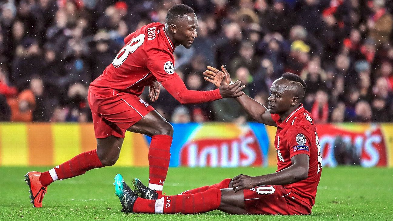 Naby Keita helps Sadio Mane up during Liverpool's Champions League draw vs. Bayern Munich.