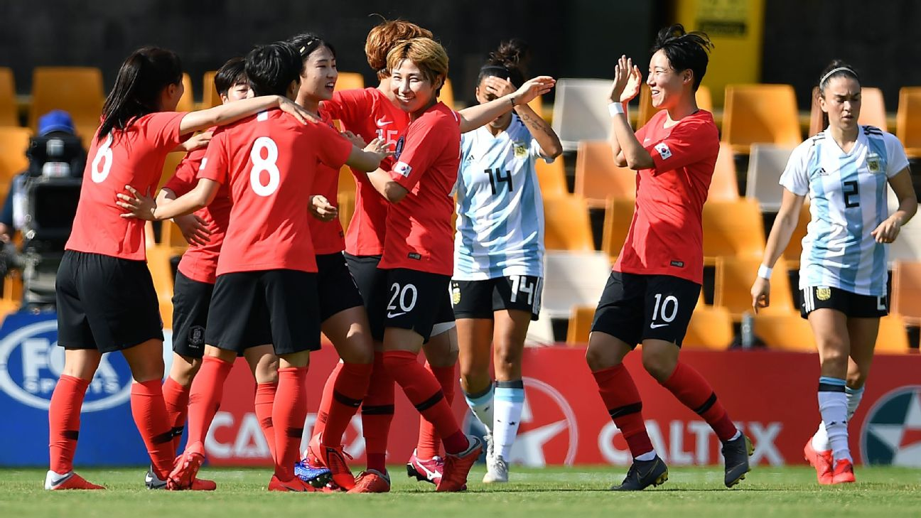 South Korea's players celebrate their first goal against Argentina during their Women's Cup of Nations match.