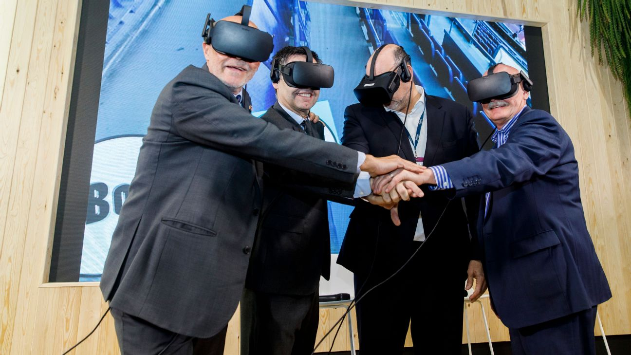 FC Barcelona executives pose for a photo wearing virtual reality headsets.