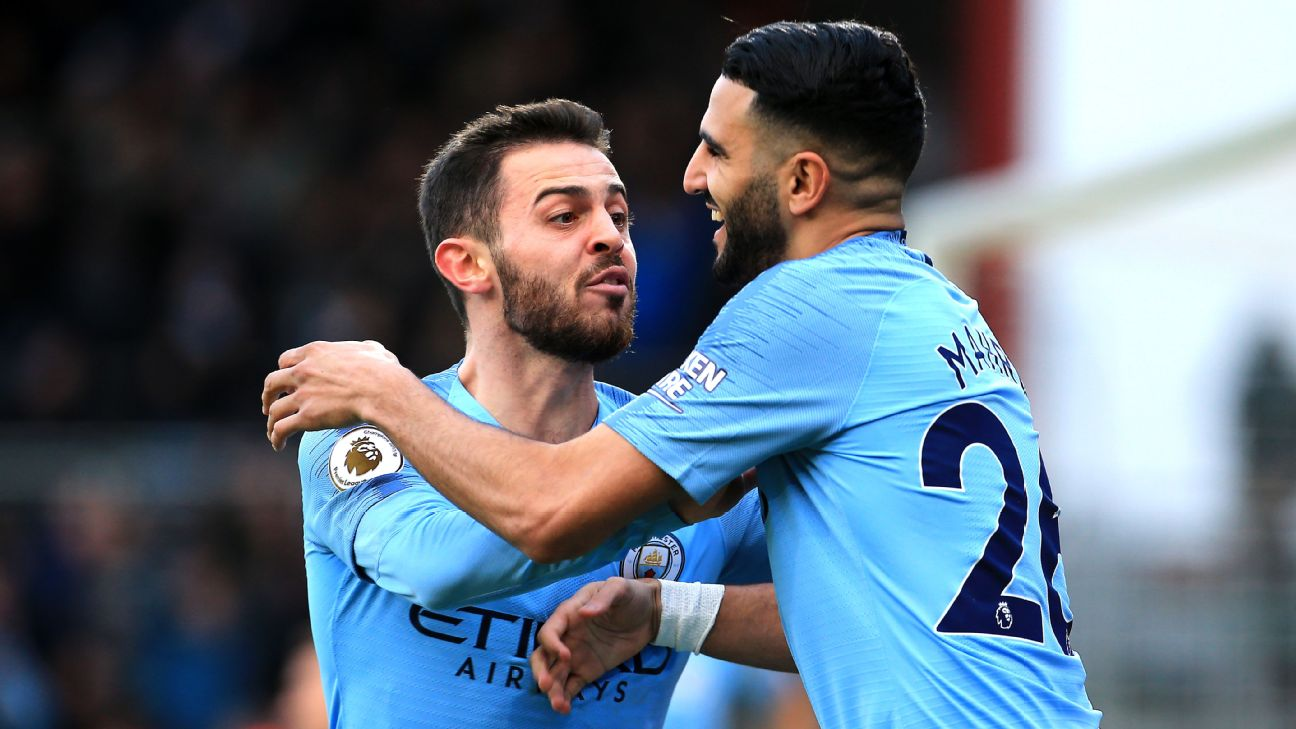 Bernardo Silva and Riyad Mahrez celebrate during Manchester City's Premier League win over Bournemouth.