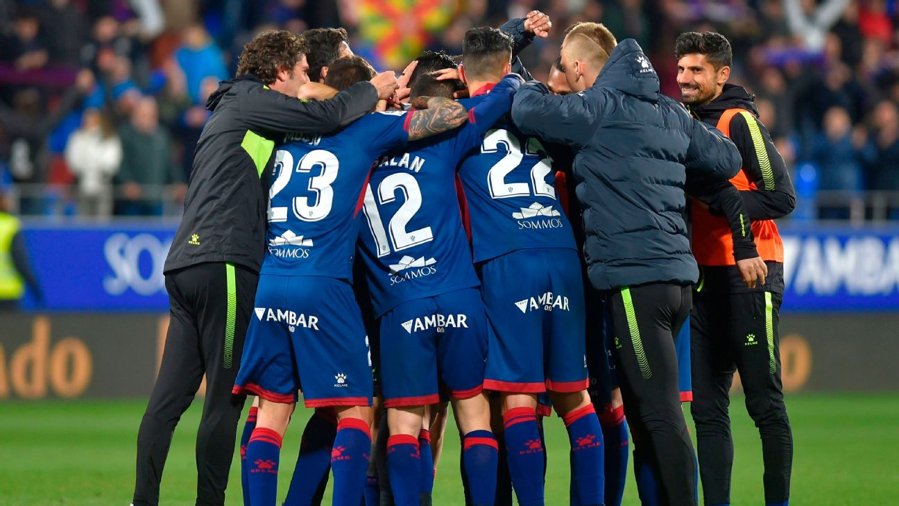 Huesca players celebrate after scoring their second goal against Sevilla