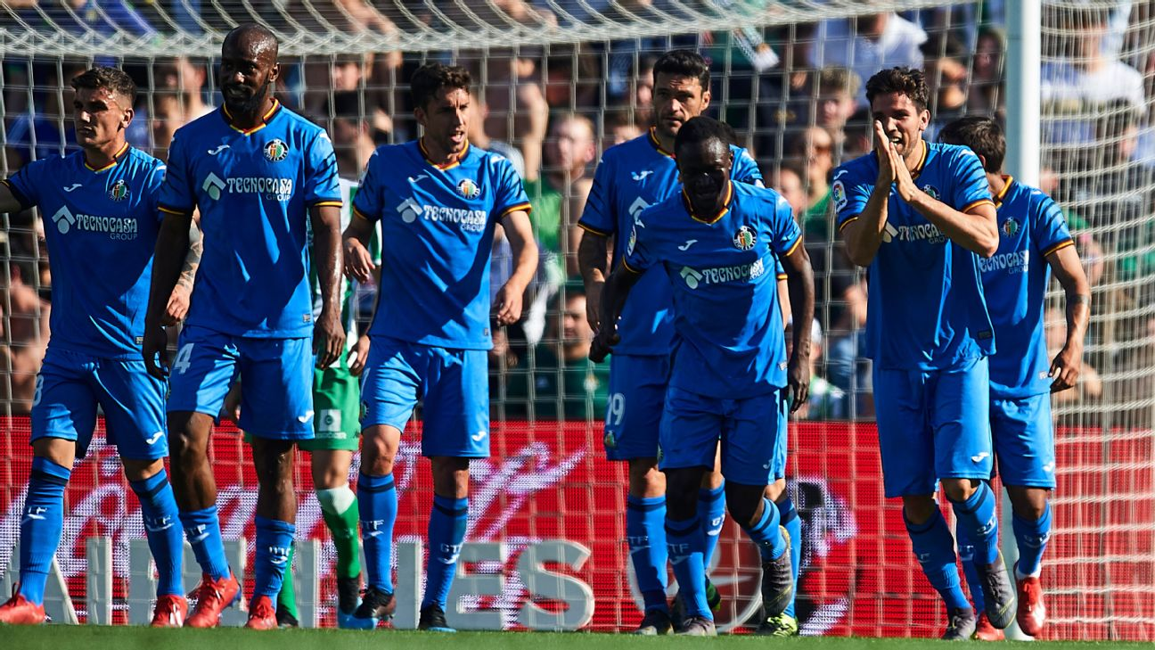 Getafe players celebrate with Leandro Cabrera after he opened the scoring