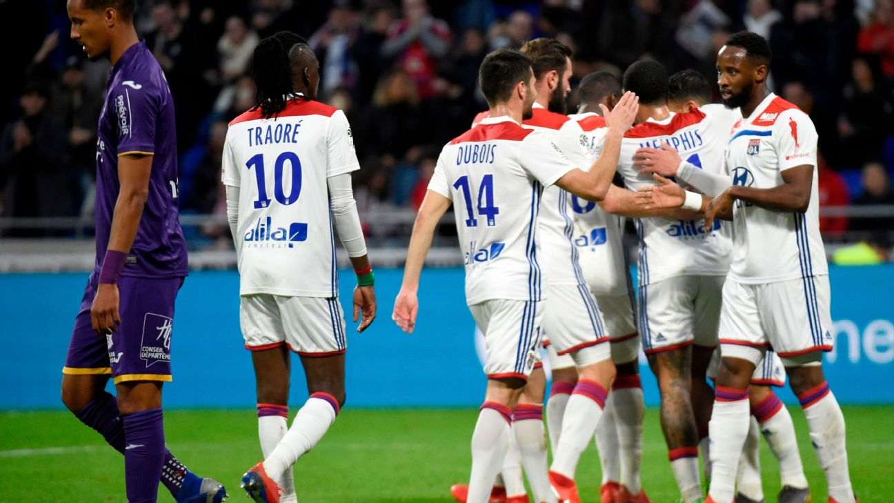 Lyon players celebrate during their 5-1 hammering of Toulouse