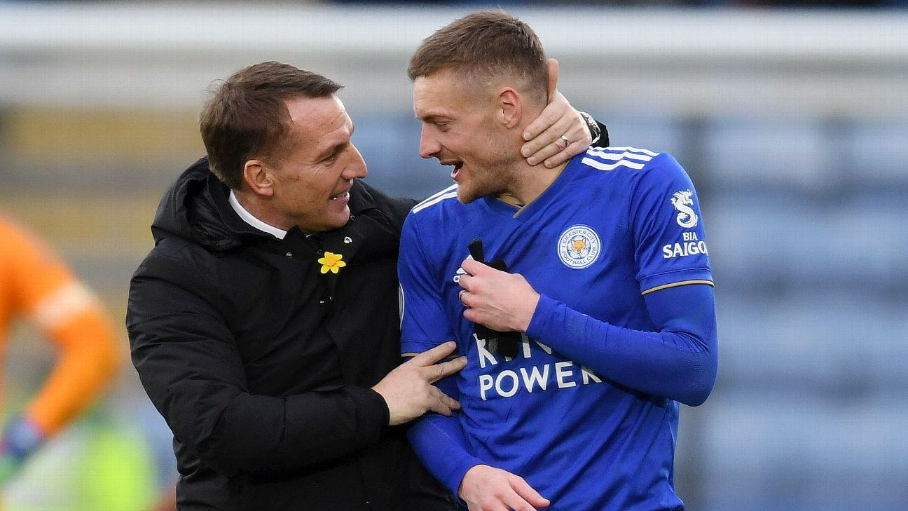 Brendan Rodgers, Manager of Leicester City congratulates Jamie Vardy of Leicester City
