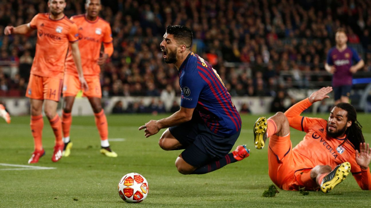 Barcelona were handed a penalty after Lyon's Jason Denayer took down Luis Suarez in the box.