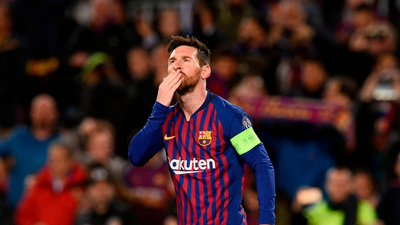 Lionel Messi celebrates after putting Barcelona ahead 1-0 in their Champions League tie with Lyon.