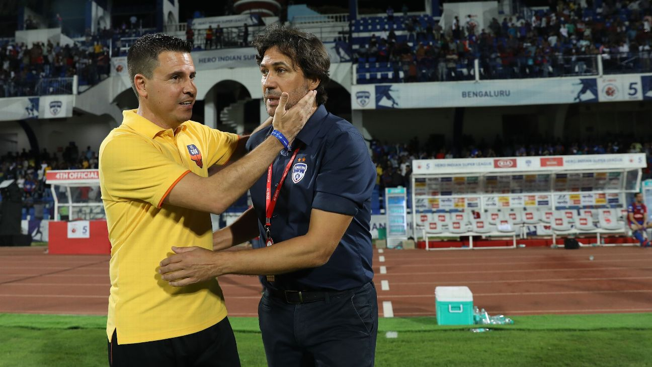 Sergio Lobera (L) and Carles Cuadrat (R) greet after Bengaluru's clash against Goa earlier in the season.