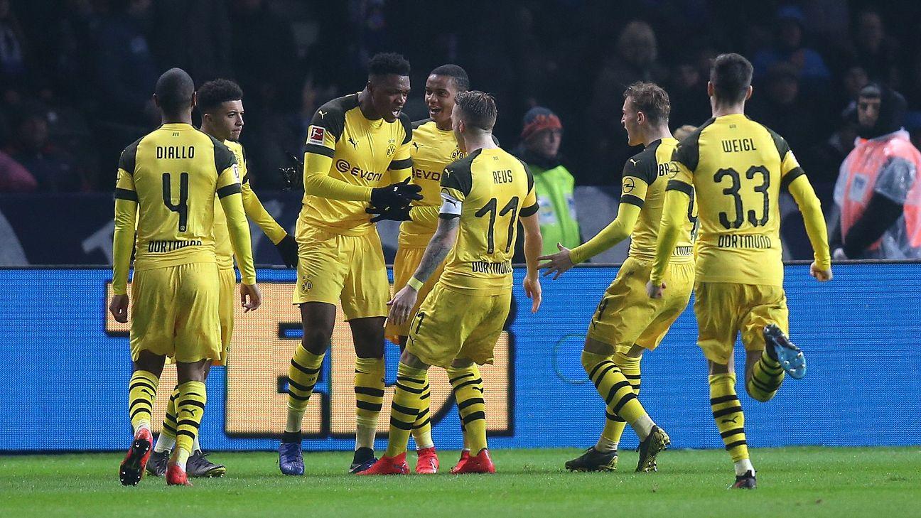 Borussia Dortmund players celebrate after scoring a goal in a dramatic win against Hertha Berlin.