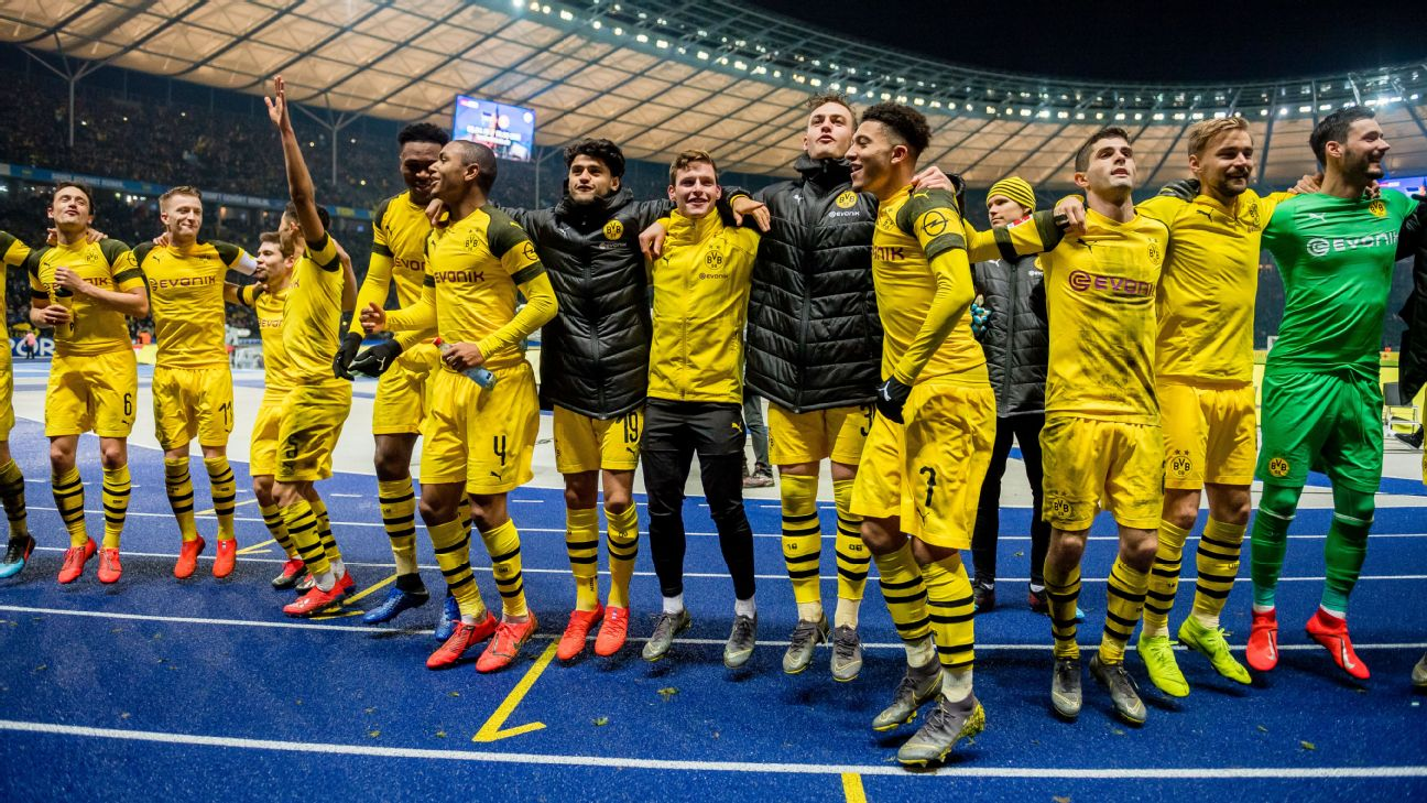 Dortmund players applaud their travelling supporters after a big win against Hertha Berlin in the Bundesliga.