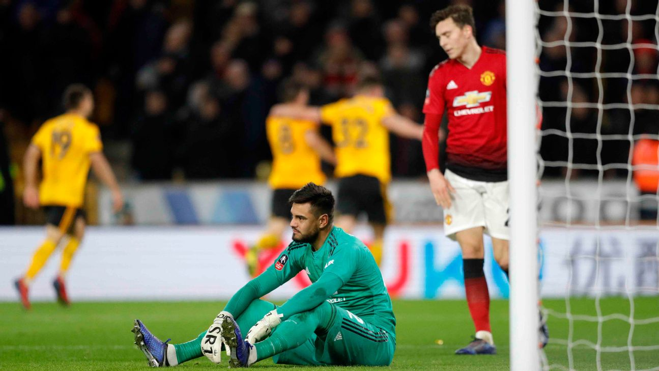 Manchester United keeper Sergio Romero, sitting, reacts after conceding a goal against Wolves in the FA Cup.