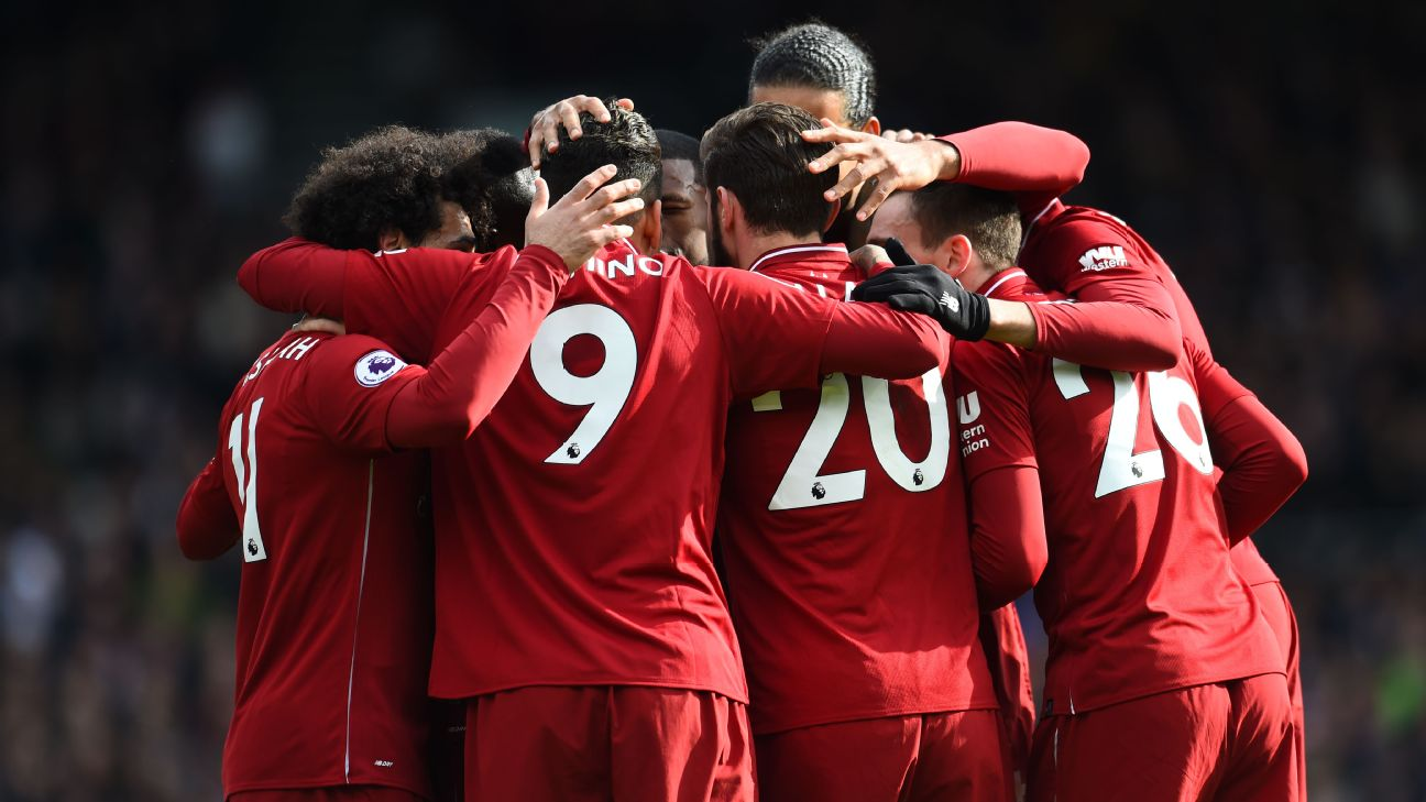 Liverpool celebrate during their Premier League win at Fulham.