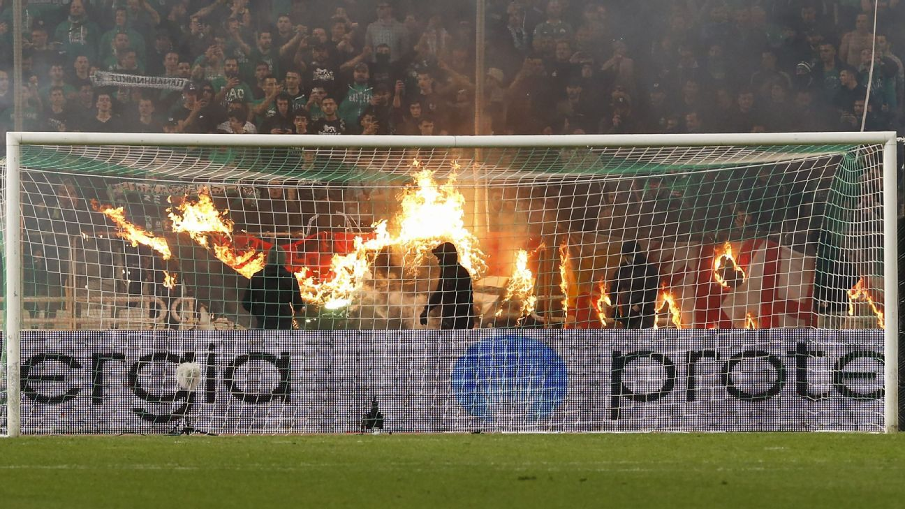 Panathinaikos fans burn a cloth banner