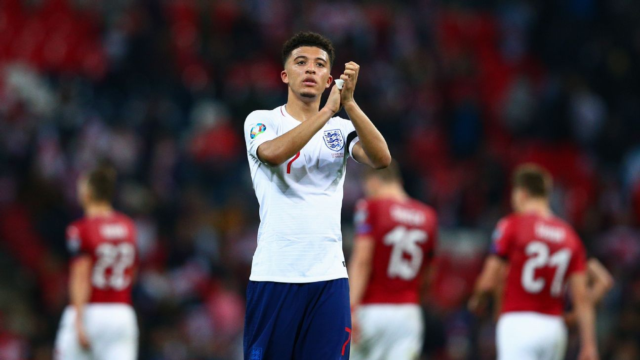 Jadon Sancho of England applauds the fans at the final whistle following his winning full senior debut with the national team.