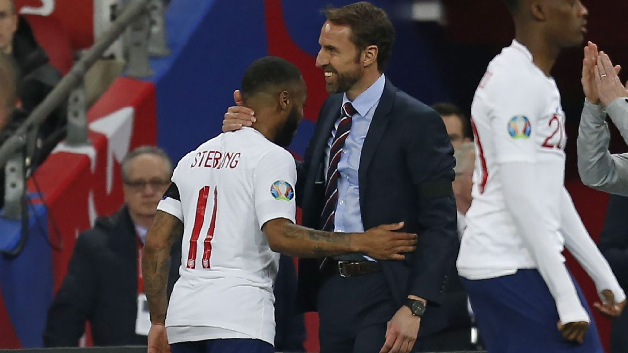 England manager Gareth Southgate congratulates Raheem Sterling after his hat trick against Czech Republic.