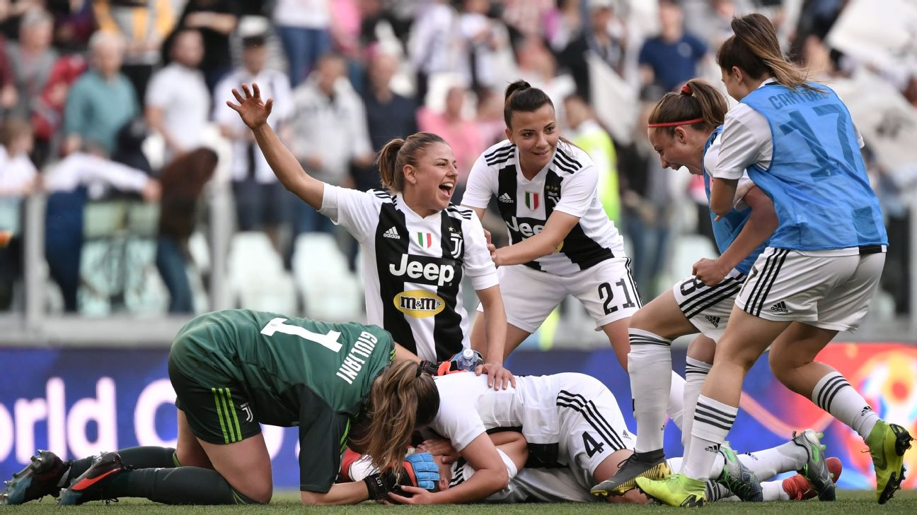 Juventus women's team players celebrate after beating Fiorentina in Serie A.