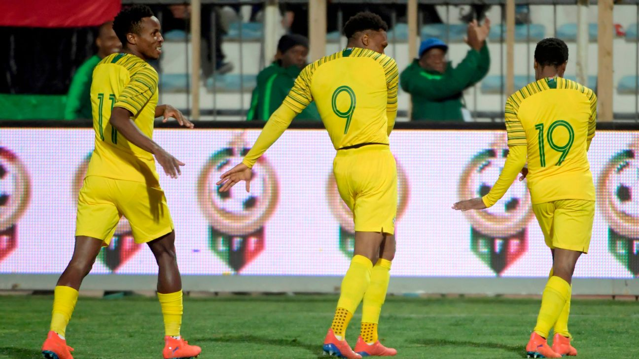 Percy Tau, right, celebrates after scoring a goal for South Africa against Libya.