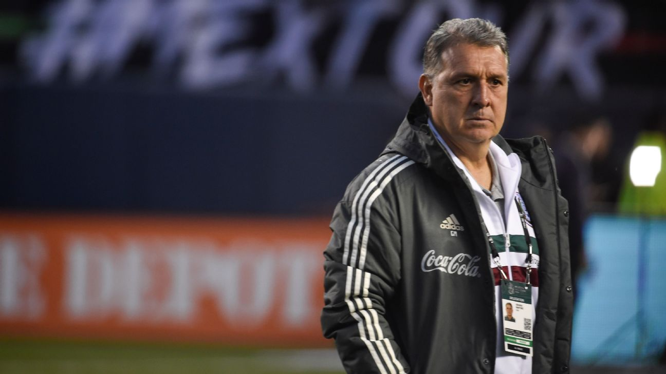 Mexico manager Gerardo Martino watches as his team warms up ahead of a friendly match against Chile in San Diego.