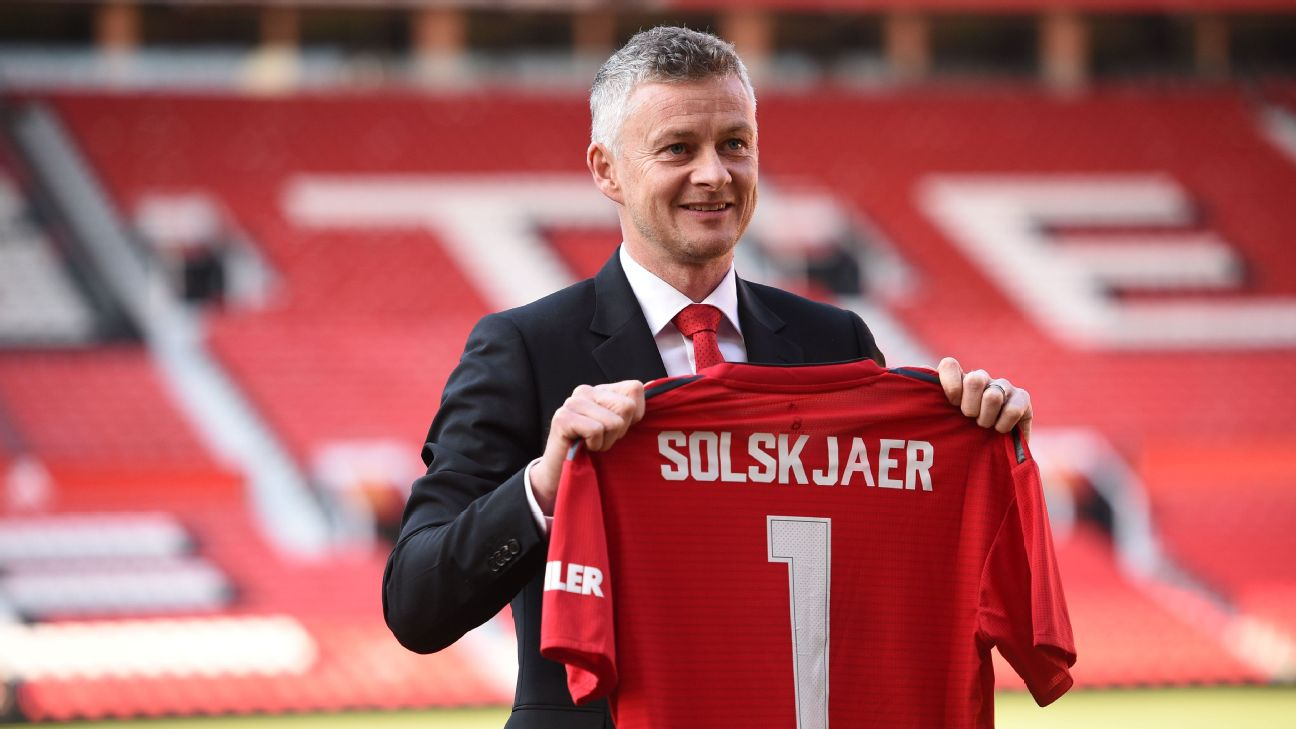 Ole Gunnar Solskjaer poses for photos after being confirmed as permanent Manchester United manager.