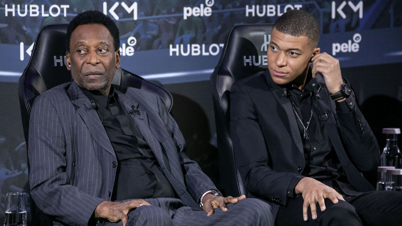 Pele, left, and Kylian Mbappe met in person for the first time at an event in Paris.