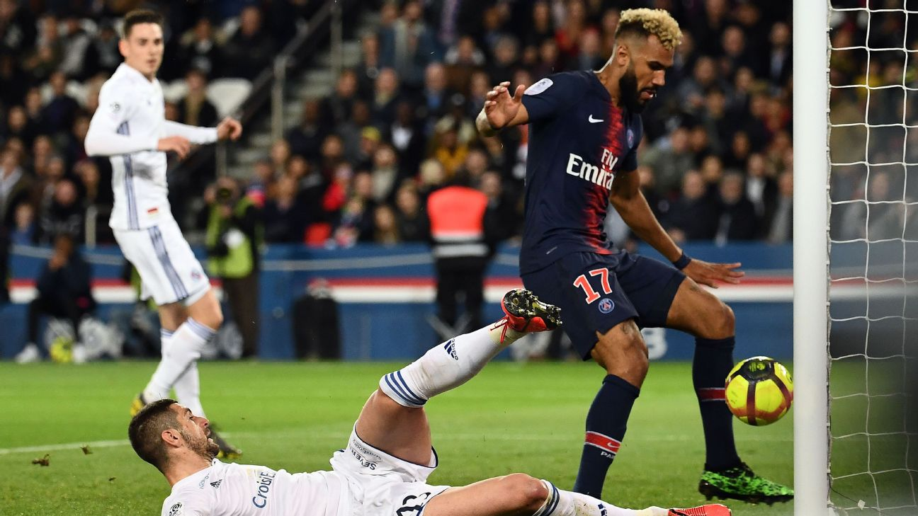 Paris Saint-Germain forward Eric Choupo-Moting accidentally clears the ball off Strasbourg's line preventing a goal.