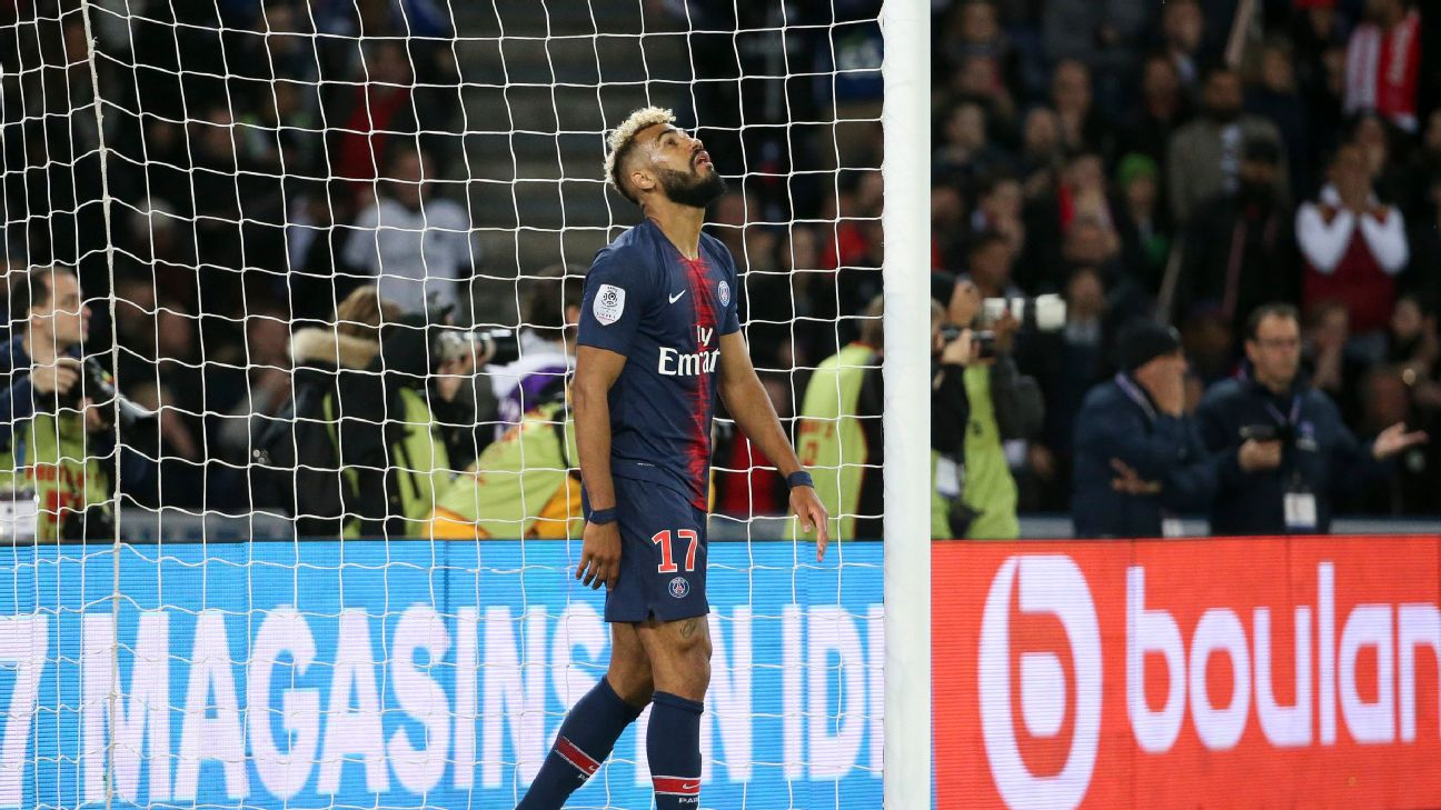 Eric Maxim Choupo-Moting of PSG reacts after preventing the goal of Christopher Nkunku of PSG by stopping the ball on the goal line.