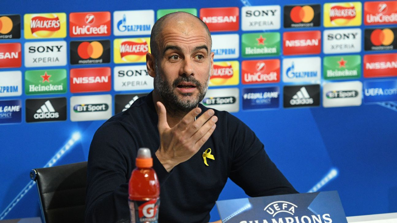 Manchester City Pep Guardiola wearing a yellow ribbon pinned to his jumped to support imprisoned Catalan pro-independence leaders, Mar. 06, 2018.
