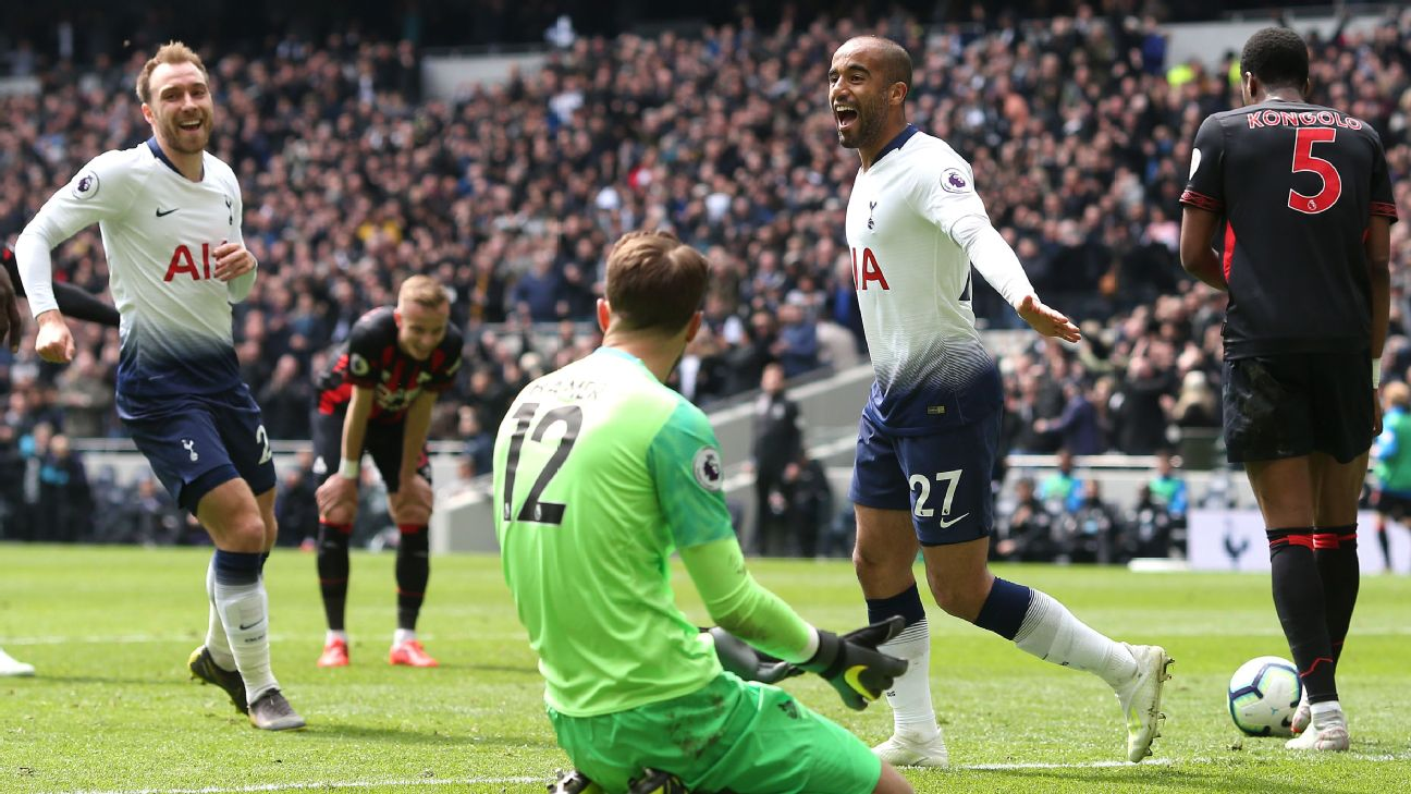 Lucas Moura of Tottenham celebrates scoring their 2nd goal while Huddersfield goalkeeper Ben Hamer looks dejected