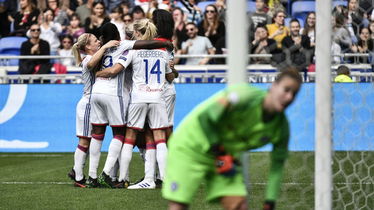 Lyon Women's team players celebrate after scoring a goal against Chelsea in their Champions League semifinal first leg.