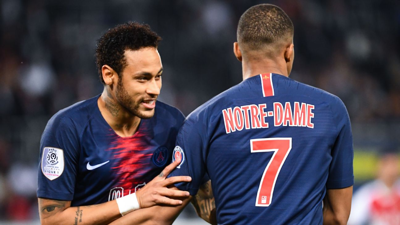 Kylian Mbappe, right, celebrates with Neymar after scoring a goal for PSG.