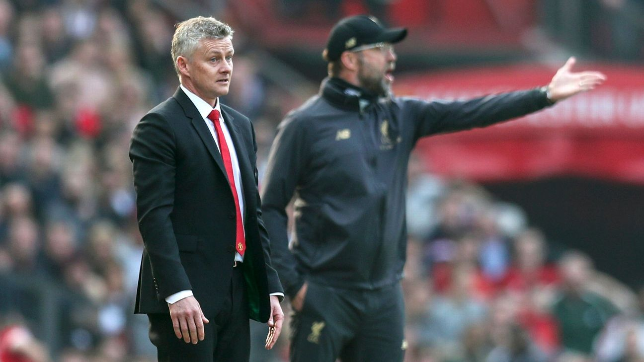 Manchester United manager Ole Gunnar Solskjaer, left, and Liverpool manager Jurgen Klopp