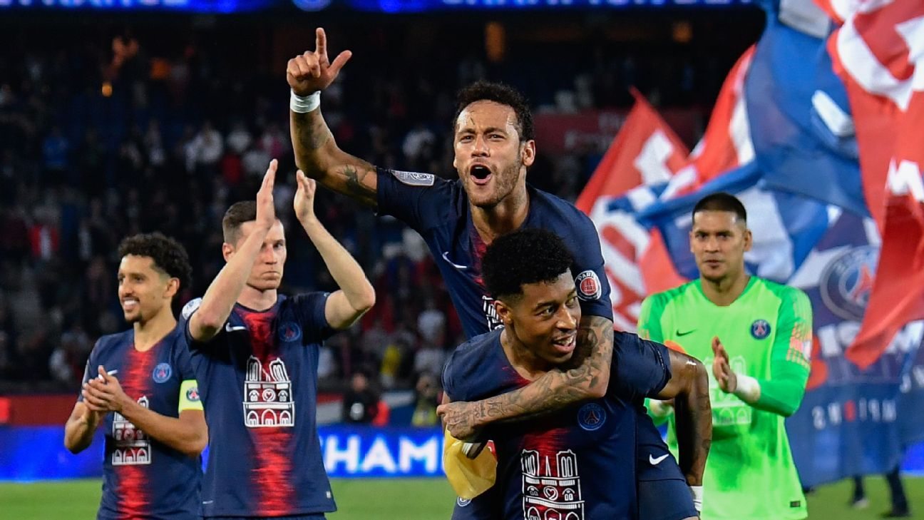 Presnel Kimpembe, whose father is Congolese, carries Neymar in celebration of PSG's Ligue 1 title win.
