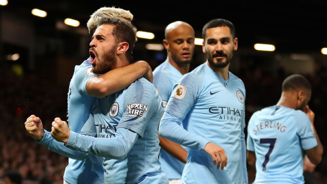 Bernardo Silva and Manchester City teammates celebrate during their Premier League win over Manchester United.