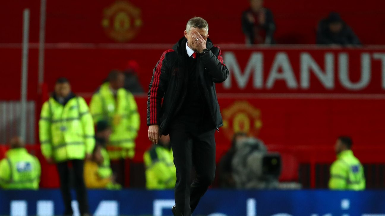 Manchester United manager Ole Gunnar Solskjaer leaves the pitch after losing to Manchester City.