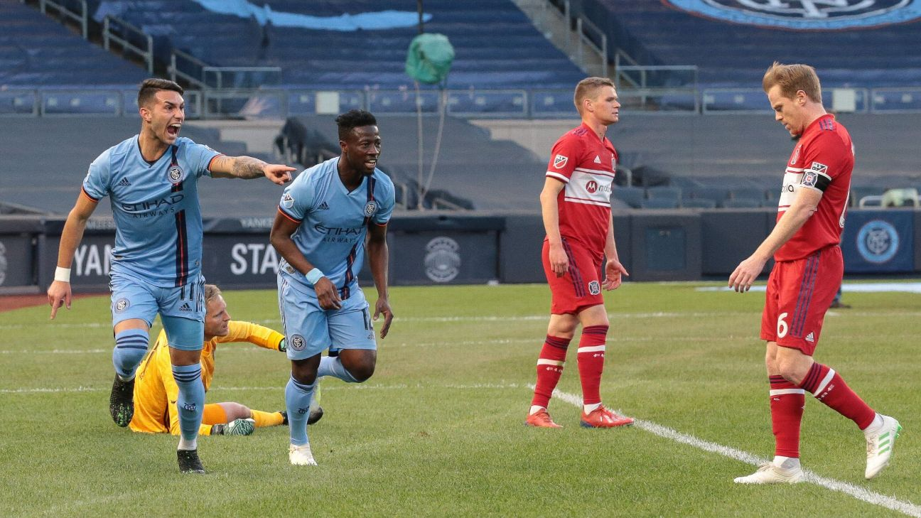 NYCFC midfielder Valentin Castellanos, middle, celebrates after scoring a goal against the Chicago Fire.