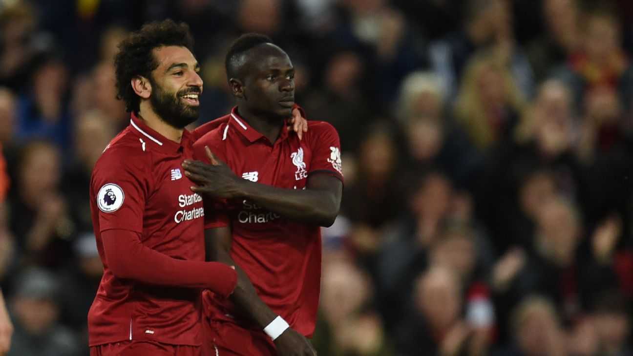 Mohamed Salah, left, and Sadio Mane both scored twice in Liverpool's 5-0 thrashing of Huddersfield Town.